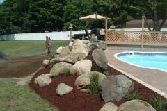 Finished: Pavers around pool / large stones